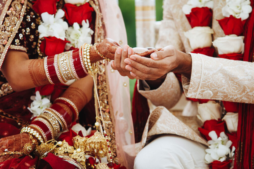 hands-indian-bride-groom-intertwined-together-making-authentic-wedding-ritual-(1)